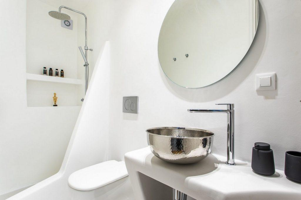 white walls of bathroom with shower and decorative sink