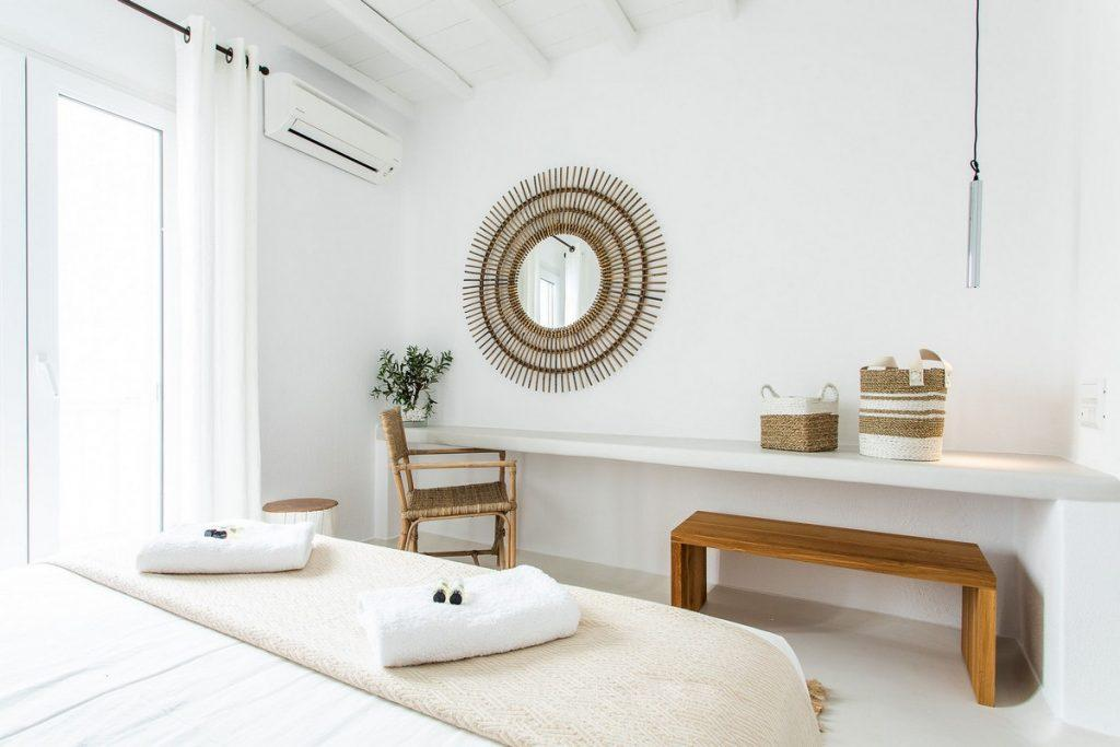 bedroom with comfortable bed and folding mirror