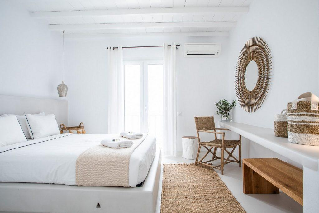 white walls of the room with decorative beige details and king size bed