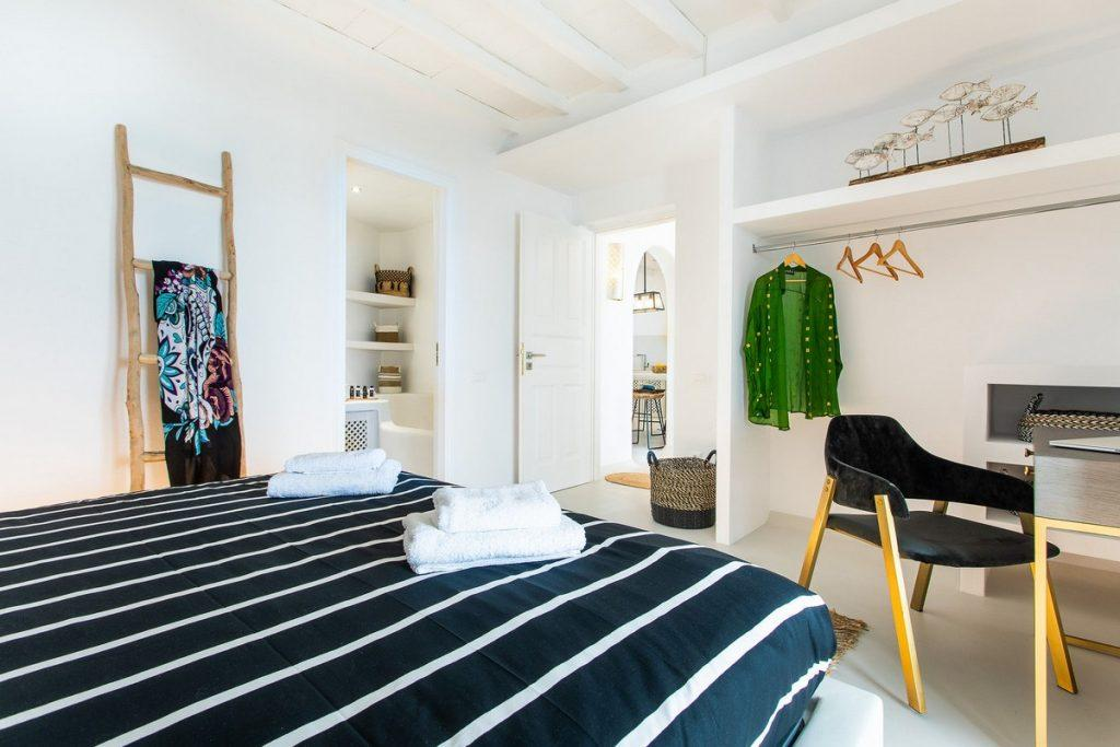 bedroom with large wardrobe and decorative details