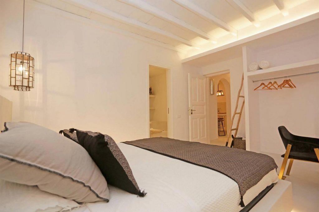 dimly lit bedroom with cozy bed ideal for pleasant night