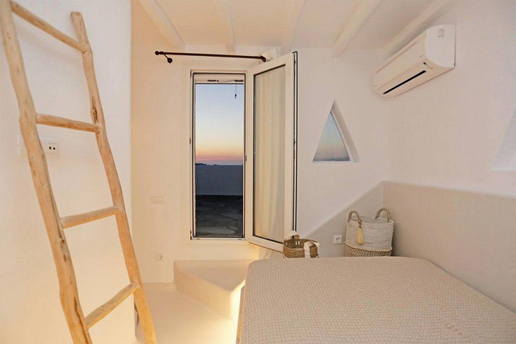 enchanting view of the sunset from a room with a comfortable bed