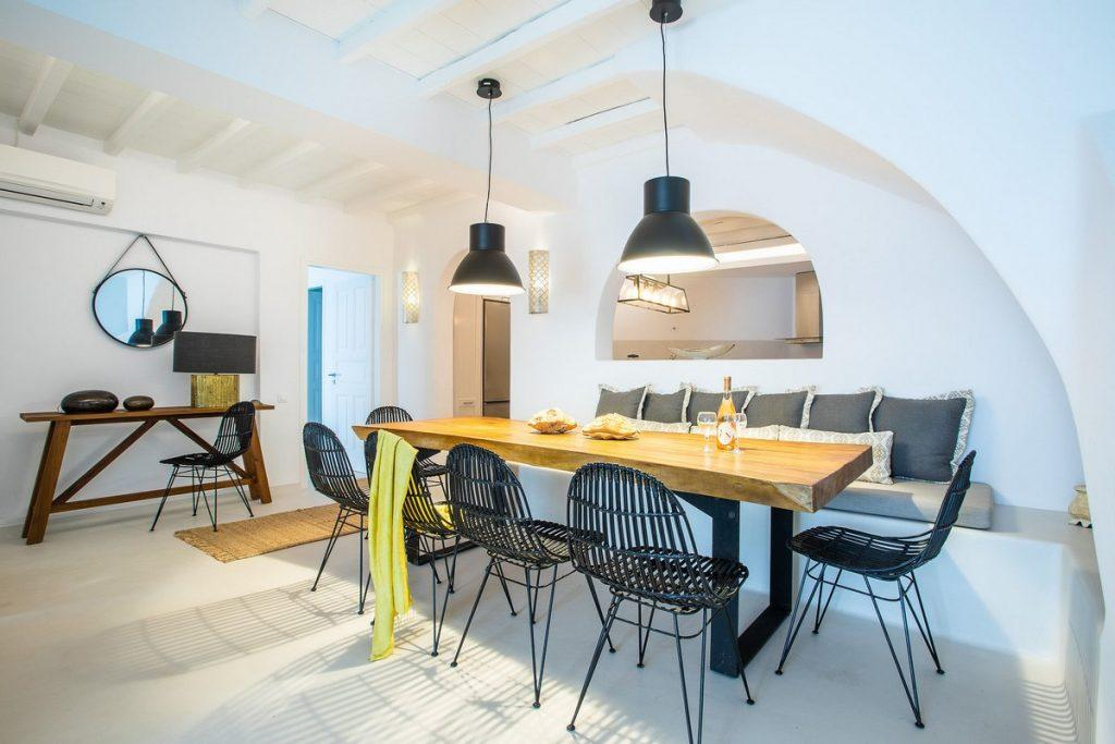 modern dining room with solid wood table and comfortable black chairs